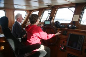 Skipper Iain and Guest in the Wheelhouse
